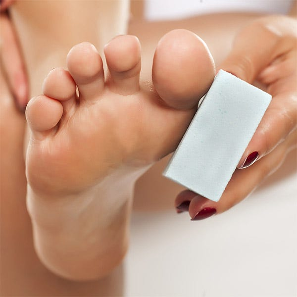 exfoliating feet with a pumice stone