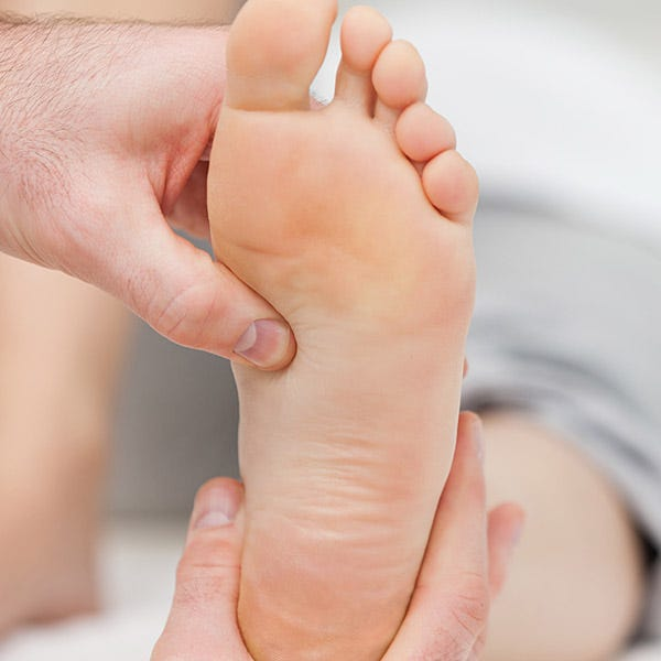 podiatrist holding a foot