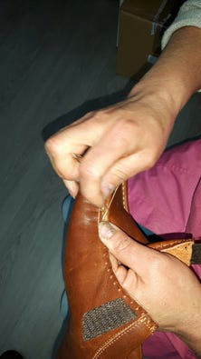 Hand-stitching the apron on Suzi