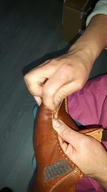 Hand-stitching the apron on Suzi