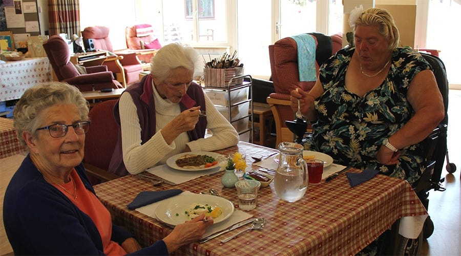 Patients at the Sunflower Centre Day Hospice enjoying lunch together