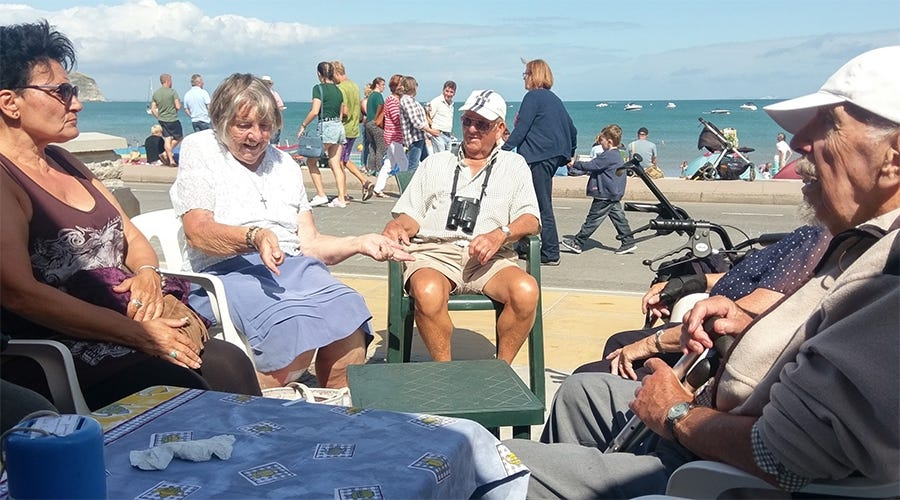 Swanage Disabled Club members by their beach hut this summer