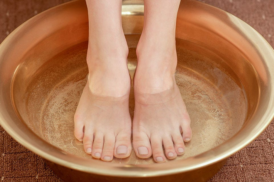 Feet in bowl of water