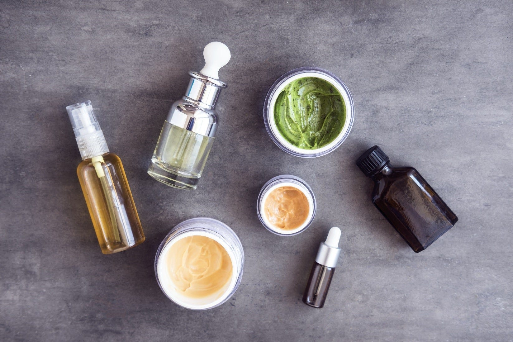 Natural skincare products on a grey background