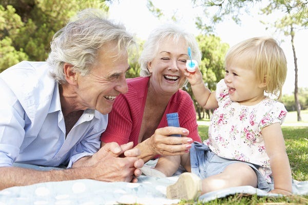 Grandparents outdoors with grandchild