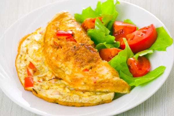 Herb omelette with fried tomatoes
