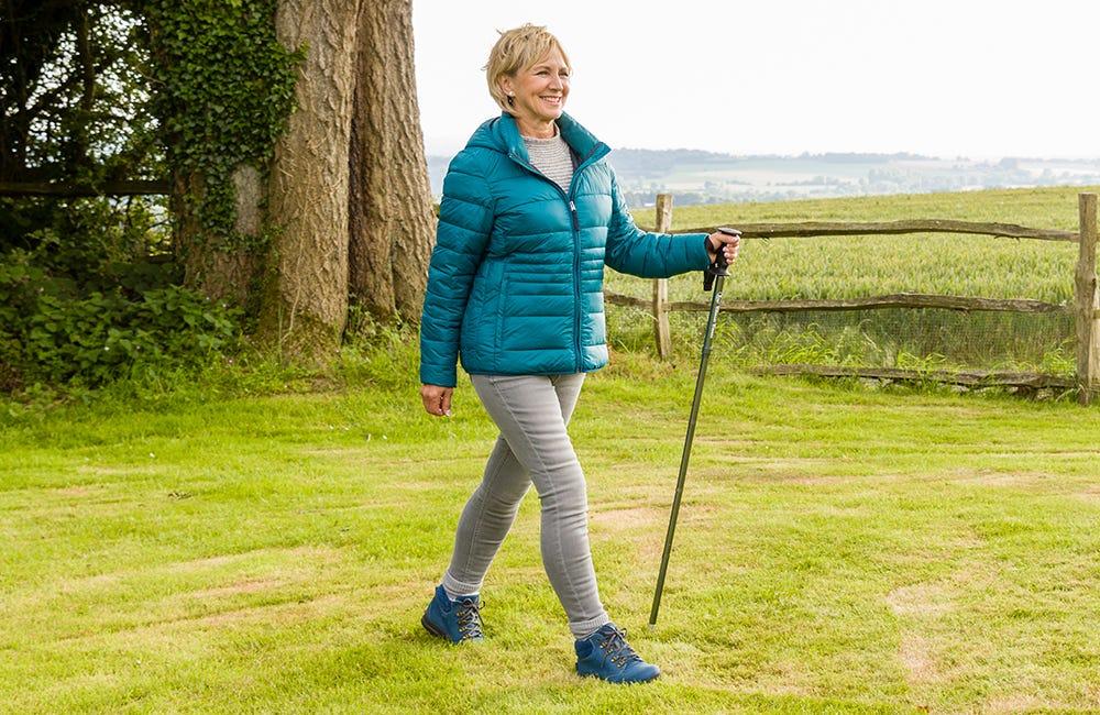 Woman walking with a Folding Hiking Pole