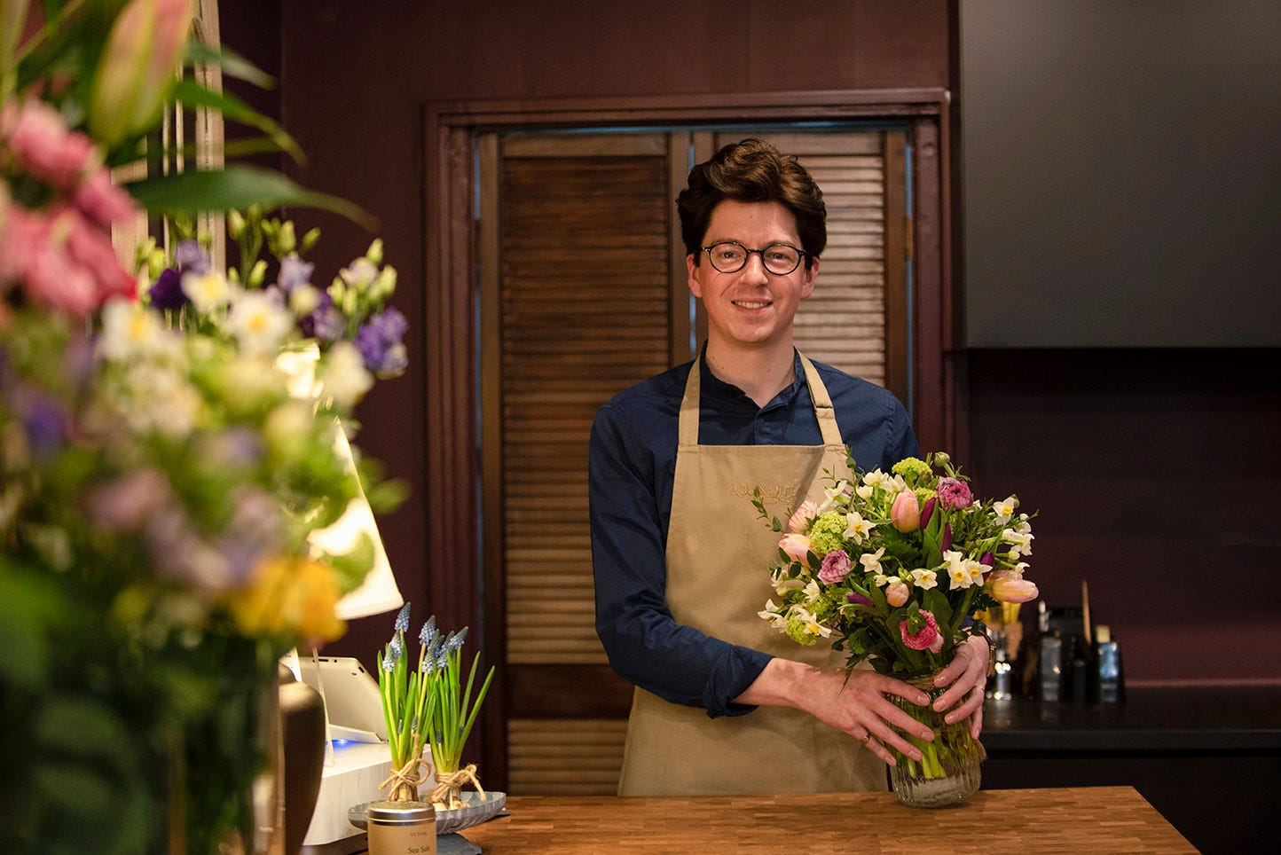 Florist Jake holding spring bouquet