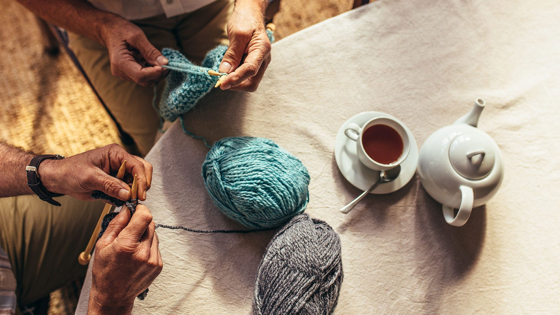 Senior people knitting