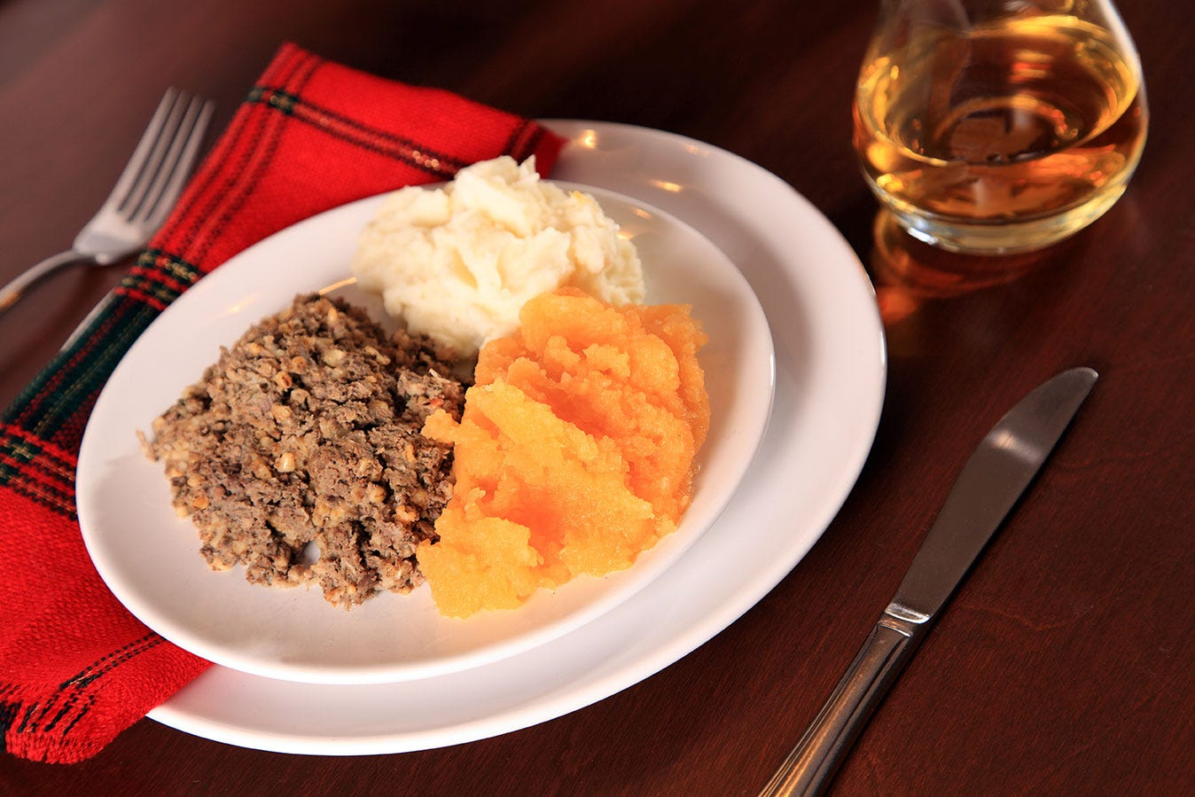 Dinner of haggis served with neeps, tatties and whiskey