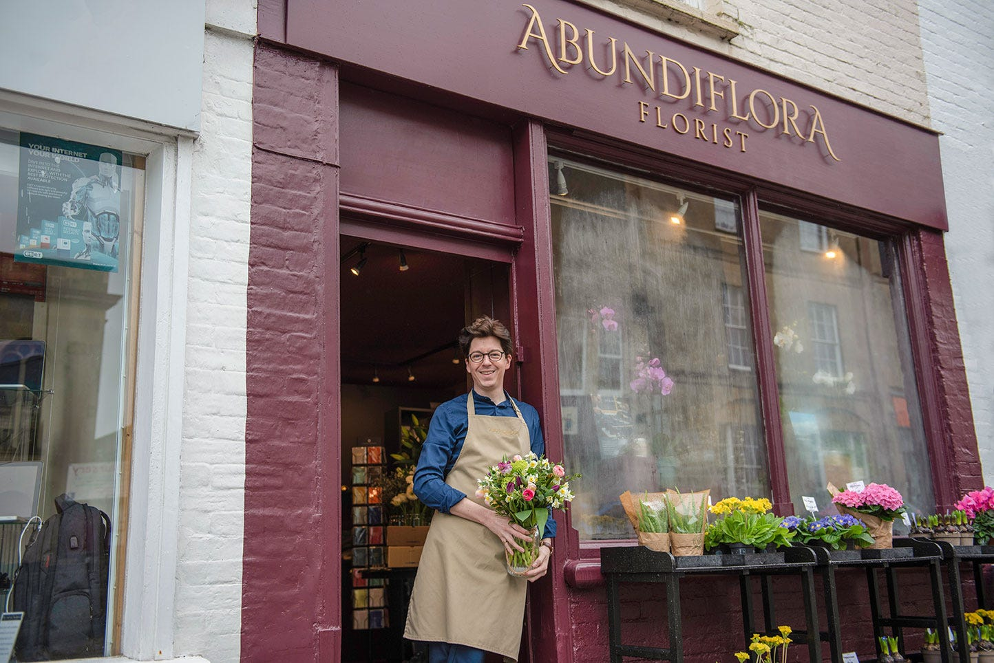 Jake outside his florist shop, Abundiflora