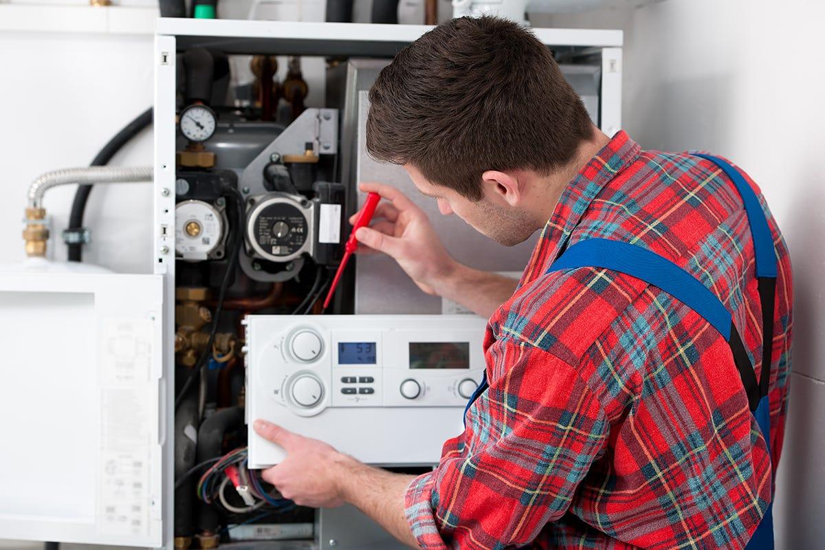 Plumber servicing a boiler