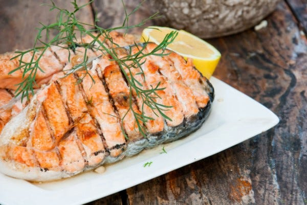 Grilled salmon steak with mustard dill sauce
