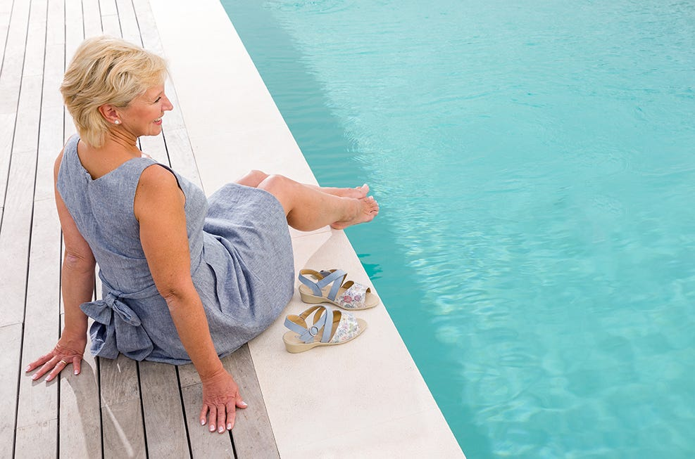 Lady sitting by pool with Salsa extra roomy sandals