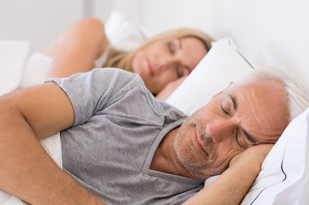 Man and woman sleeping