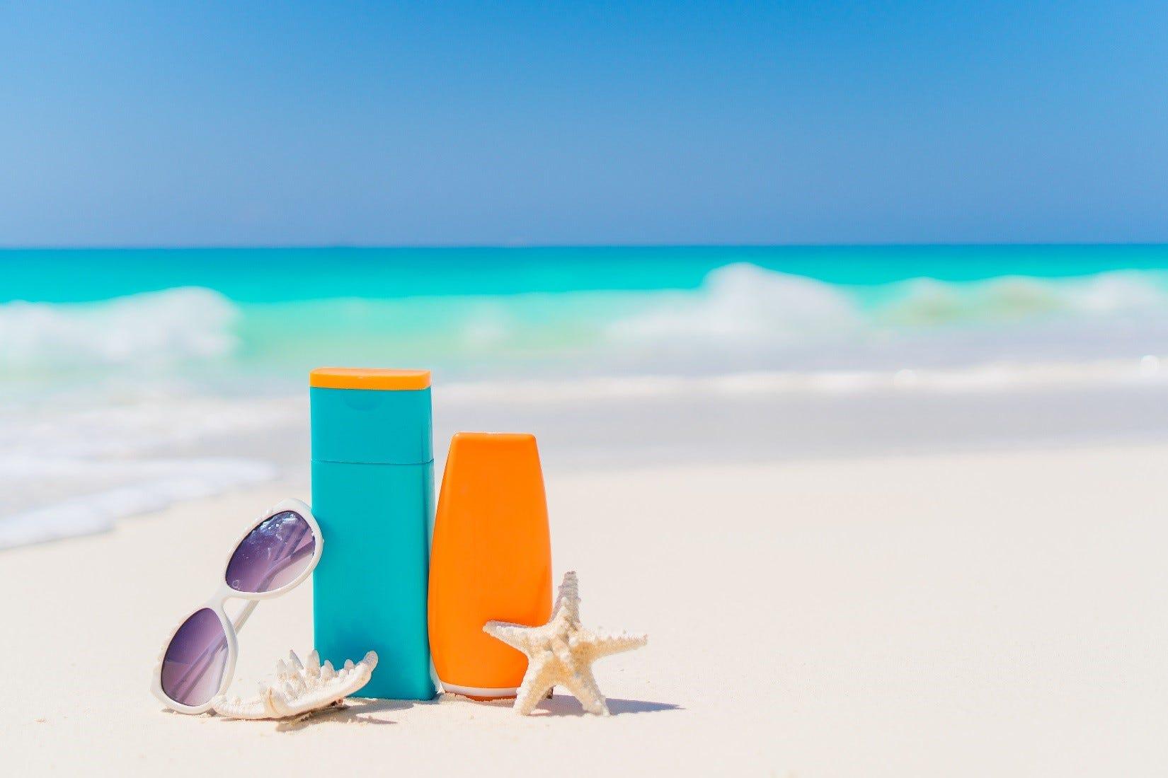 Sun cream and after sun on the beach